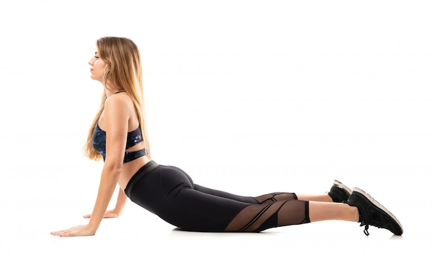 Blonde sport woman stretching isolated
