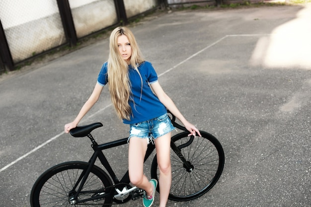 Blonde teenager with her bike