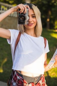 Blonde tourist with camera