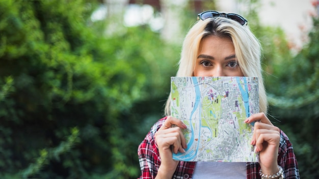 Blonde tourist with map