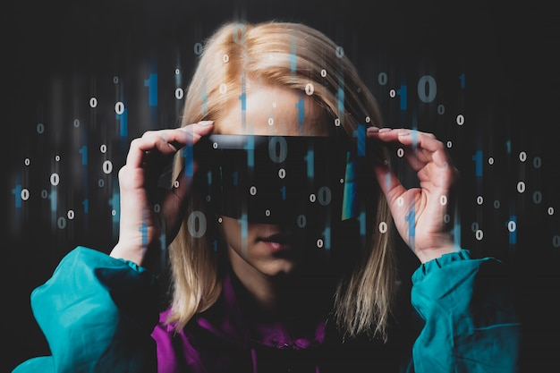 Blonde in vr glasses with binary code around