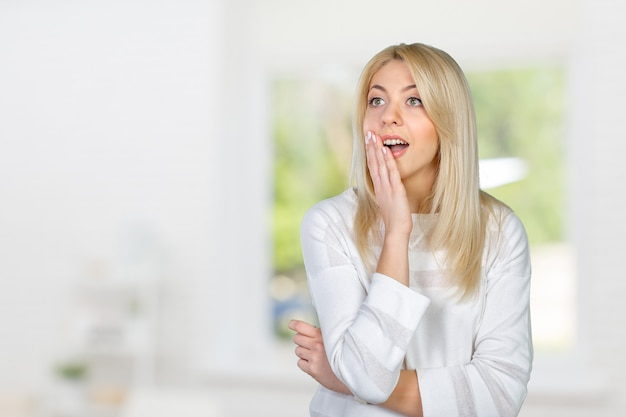 Blonde woman acting surprised and confused