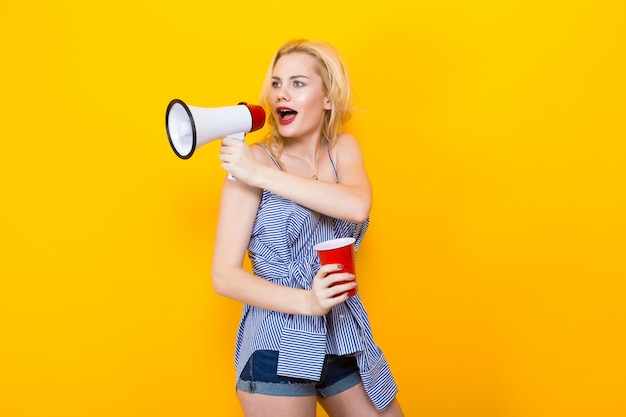 Blonde woman in blue striped blouse with megaphone