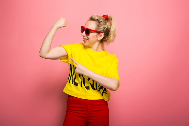 Blonde woman in bright clothes