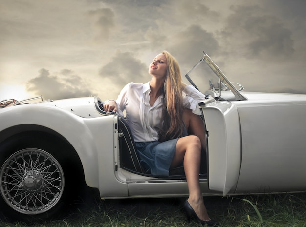 Blonde woman in a cabriolet