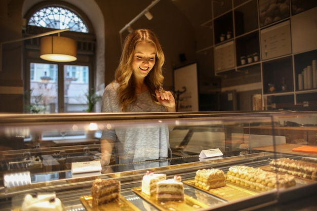 Blonde woman in a cake shop