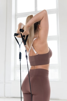 Blonde woman doing back exercises