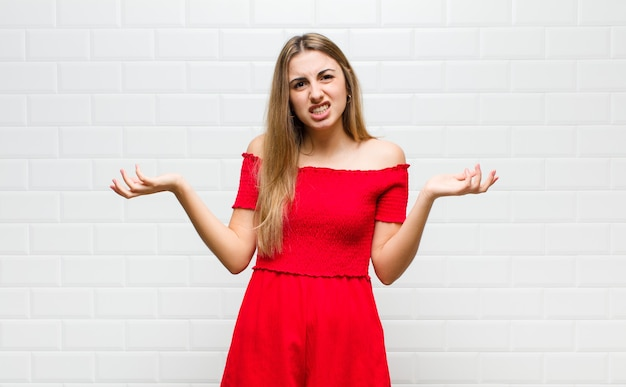 Blonde woman feeling clueless and confused, not sure which choice or option to pick, wondering