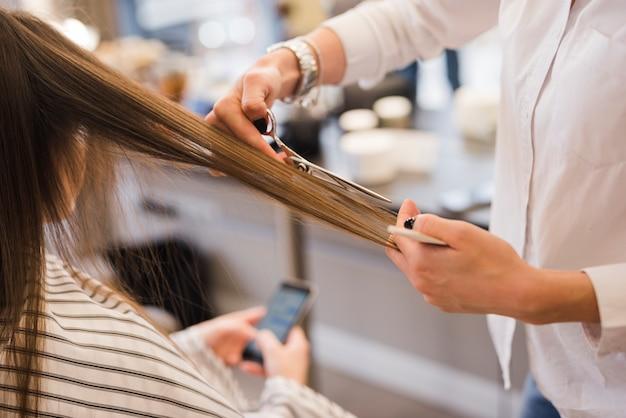 Blonde woman getting her hair cut