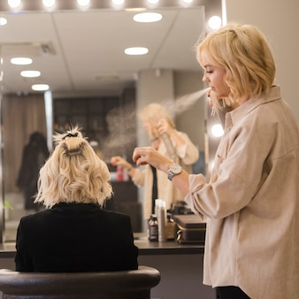 Blonde woman getting her hair done