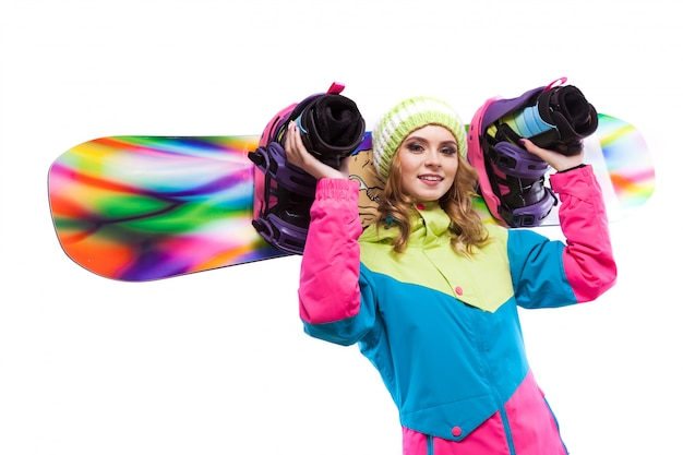 Blonde woman hold snowboard on sholders