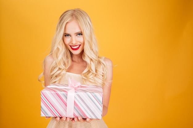 Blonde woman holding gift.
