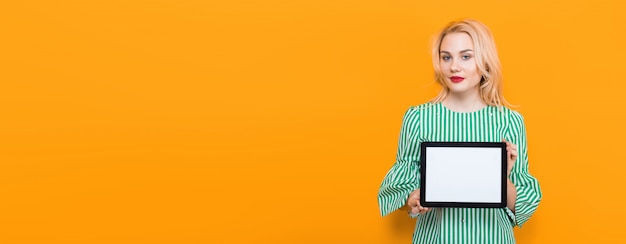 Blonde woman holding tablet computer