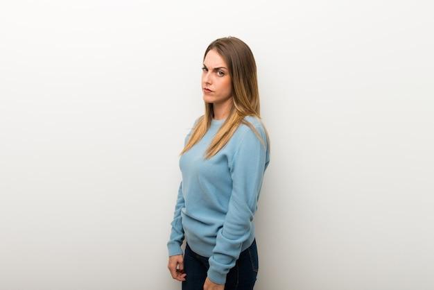 Blonde woman on isolated white background feeling upset