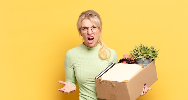 Blonde woman looking angry, annoyed and frustrated screaming wtf