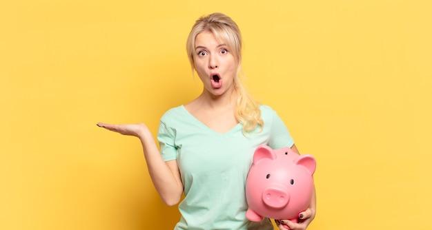 Blonde woman looking surprised and shocked