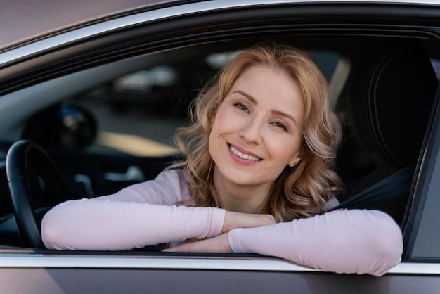 Blonde woman portrait in car