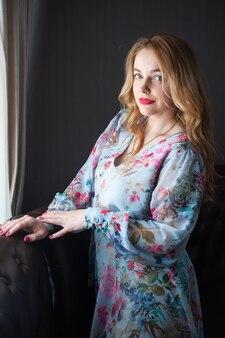 Blonde woman portrait in the summer dress