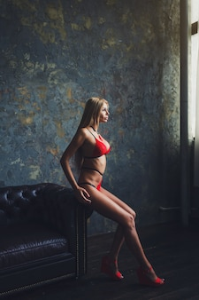 Blonde woman posing in sexy red