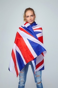 Blonde woman. posing with uk flag