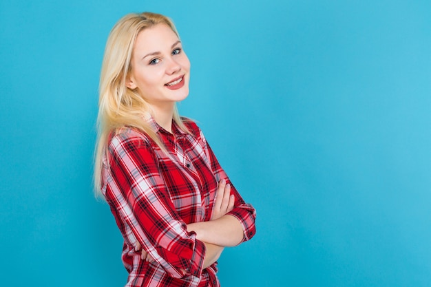 Blonde woman in red checkered shirt