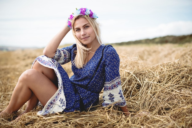 Blonde woman sitting in field