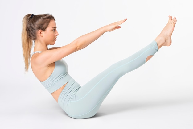 Blonde woman stretching in blue gym outfit