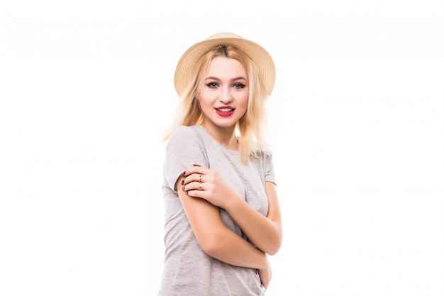 Blonde woman with big eyes stay in front of white wall