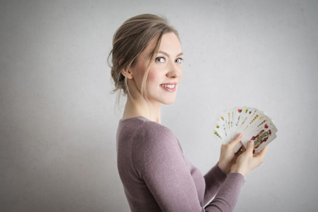 Blonde woman with cards