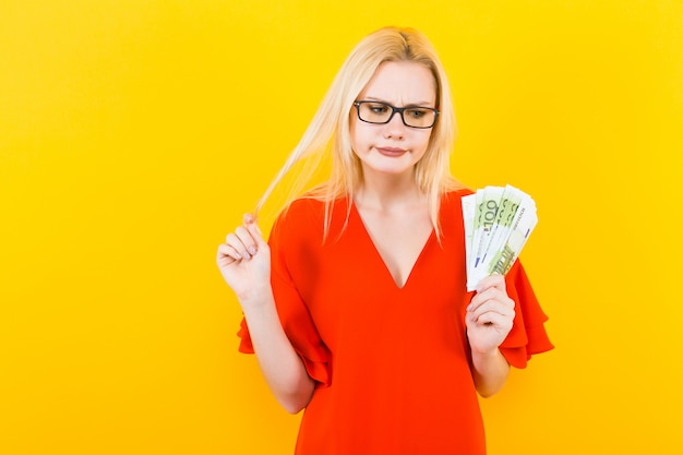 Blonde woman with cash