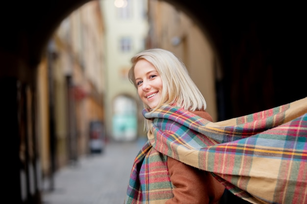 Blonde woman with scarf in old town of wroclaw