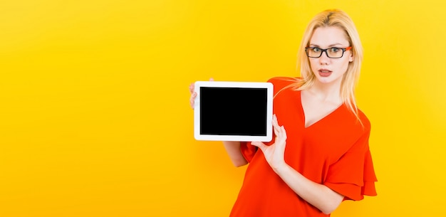 Blonde woman with tablet pc