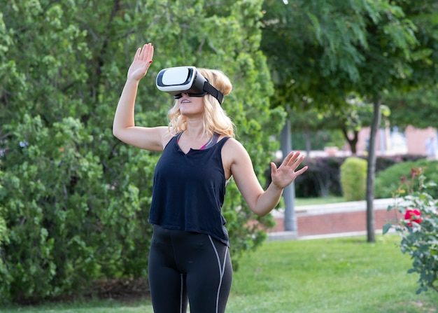 Blonde woman with virtual reality glasses