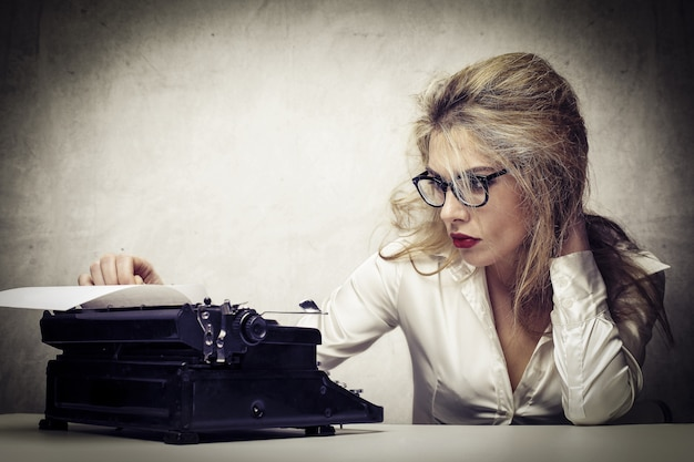 A blonde woman writer working
