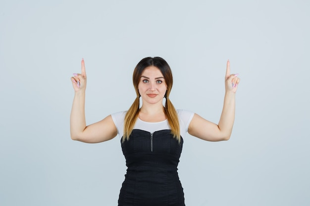 Blonde young lady in dress gesturing isolated