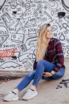 Blonde young woman on a skatepark