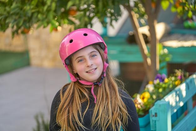 Blonk kid skate girl helmet portrait smiling