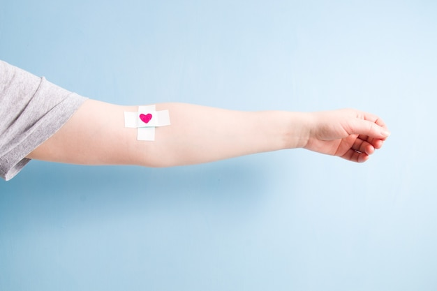 Blood donor concept, blue background, copy space