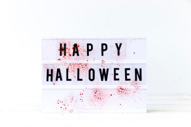 Blood on happy halloween writing