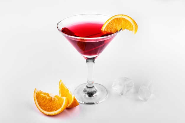 Blood orange gin and tonic cocktail served with slices of orange in a glass