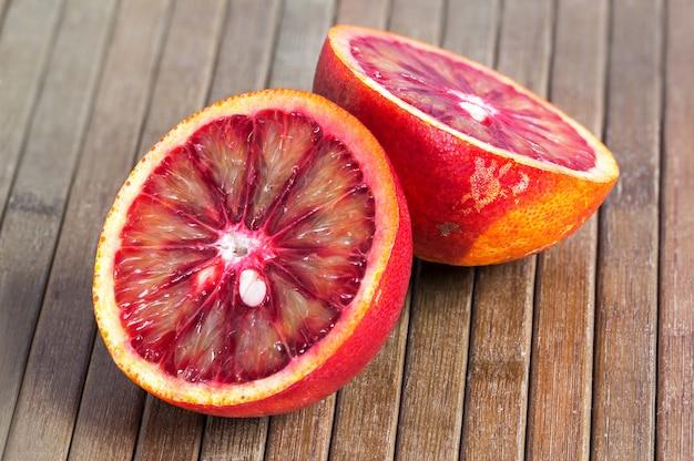 Blood orange on a wooden striped
