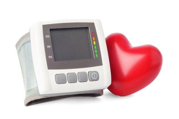 Blood pressure monitor and heart on white