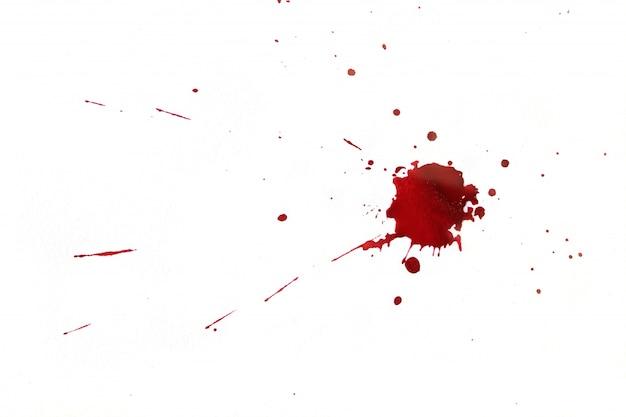 白い背景に血液がはねます。