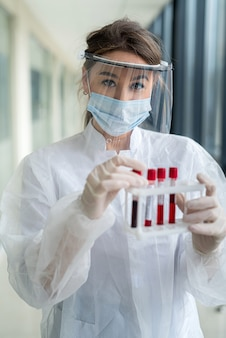 Blood tests for coronavirus disease. a nurse works during a covid pandemic19