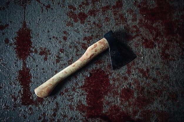 Bloody ax of maniac lying on the floor