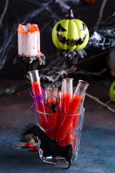 Bloody cocktail in glass tubes for halloween party celebration.