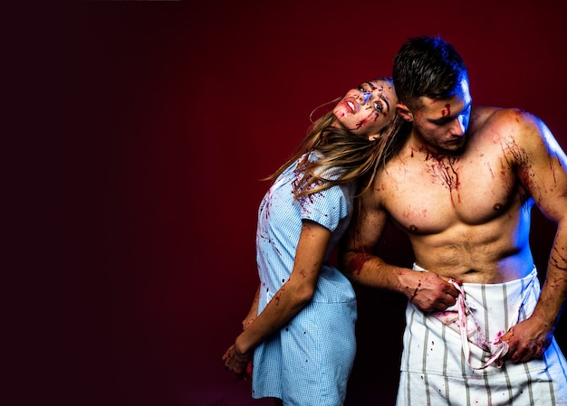 Bloody halloween couple in love together animal hunger muscular man in blood butchery