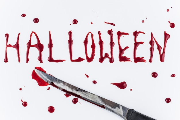 Bloody halloween word and knife