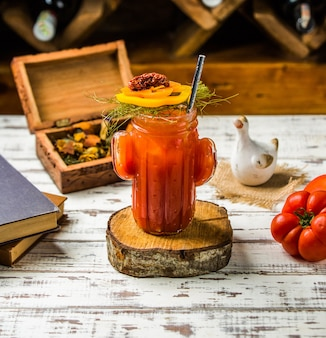 Bloody mary cocktail with tomatoes and vegetables.