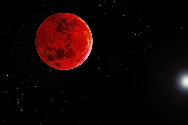 Кровавая луна на темном фоне. элементы этого изображения были предоставлены наса. фото высокого качества